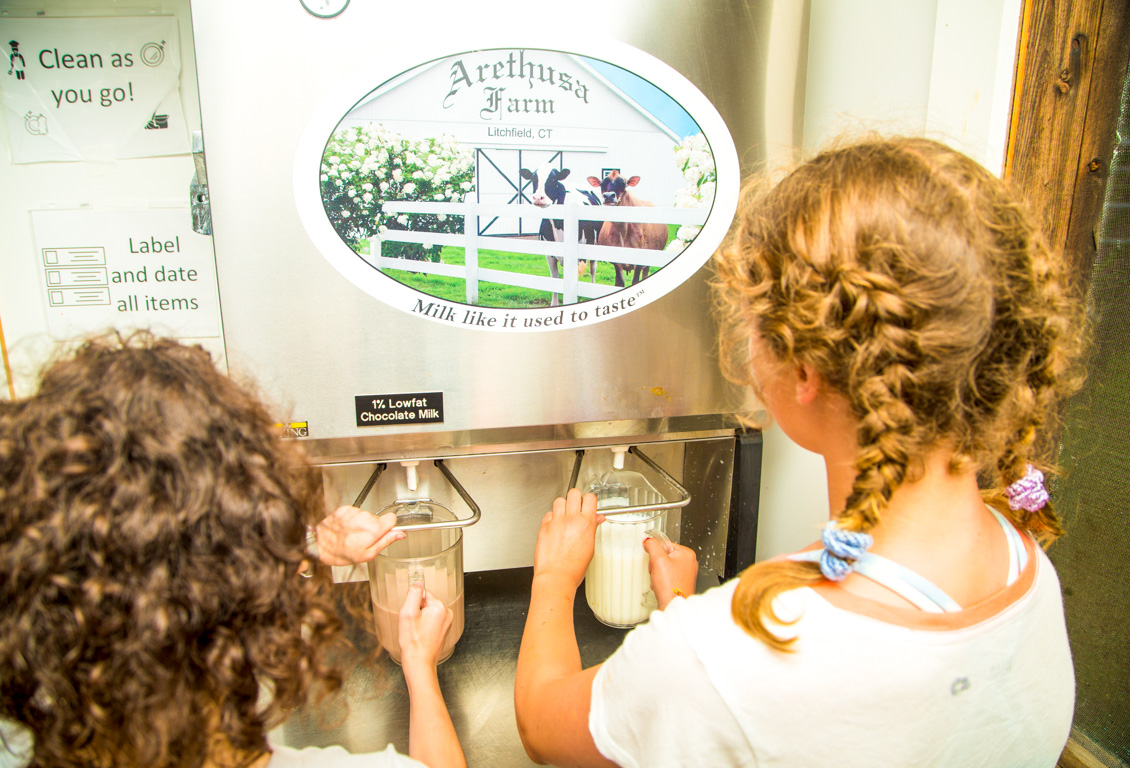 Campers get fresh milk from dispenser