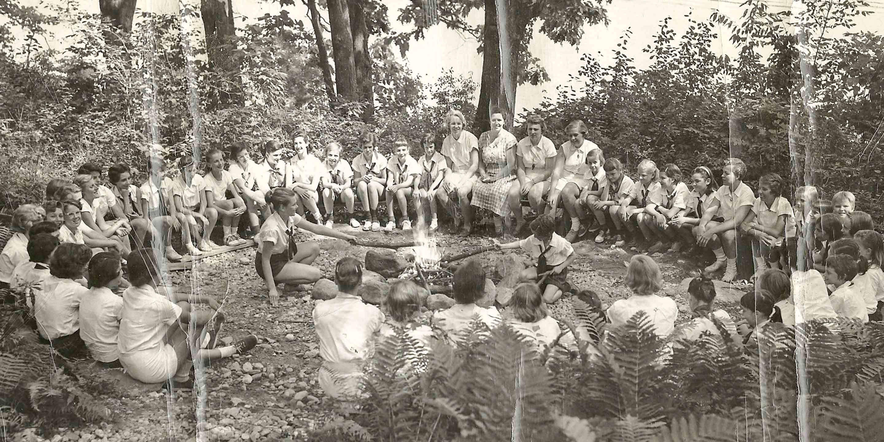 Historical black and white photo of Chinqueka campfire gathering